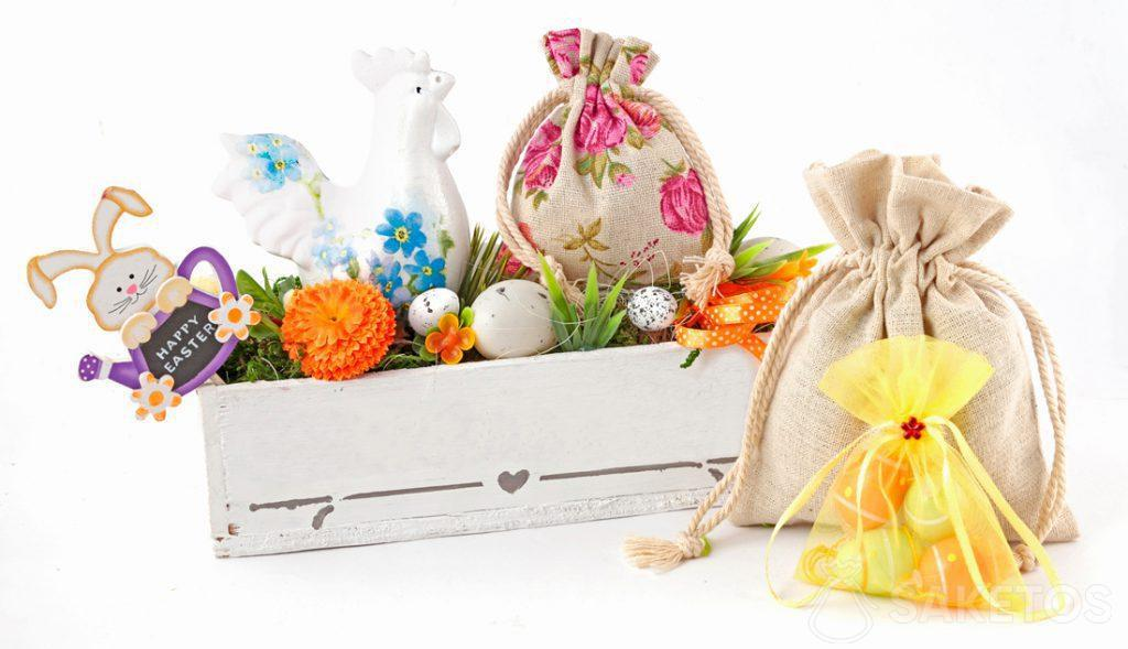 A colourful Easter composition created from cloth bags and a rectangular flowerpot with Easter eggs