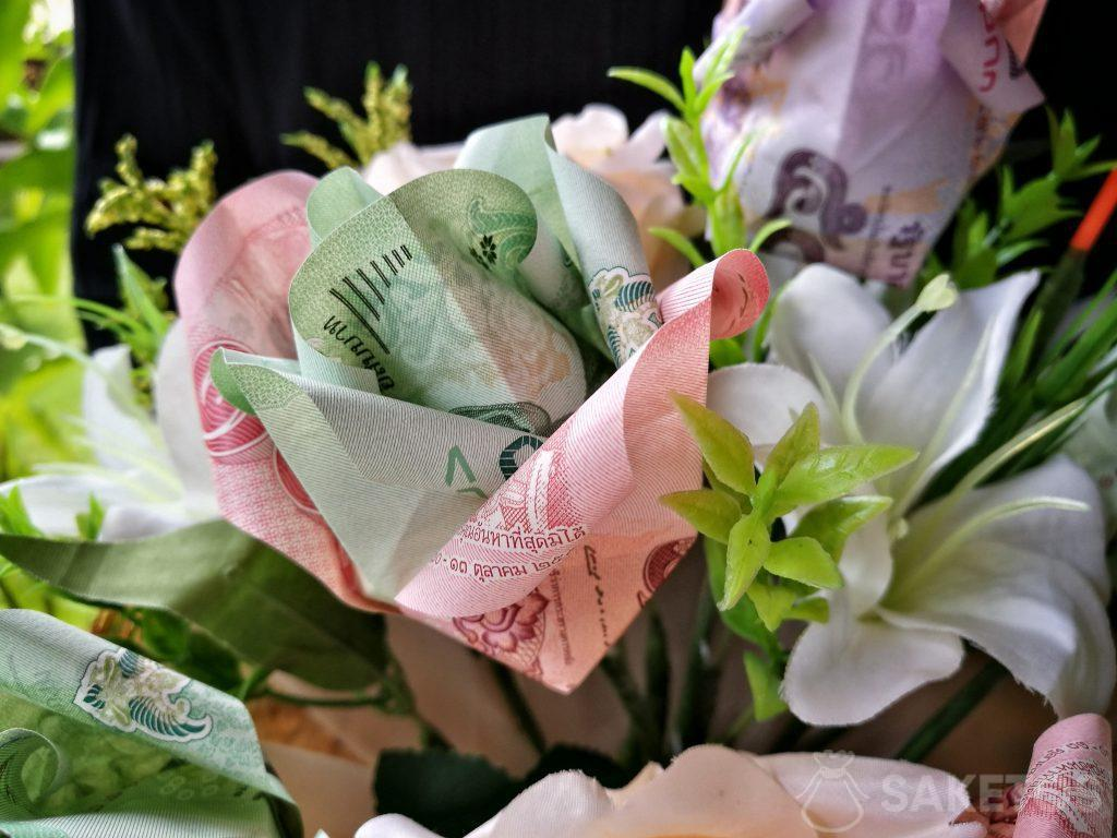 Wedding bouquet with origami flowers made of banknotes
