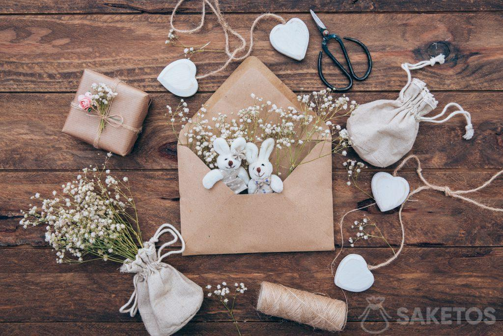 Linen bag with plaster, plush bunnies in an envelope and a gift wrapped in gray paper