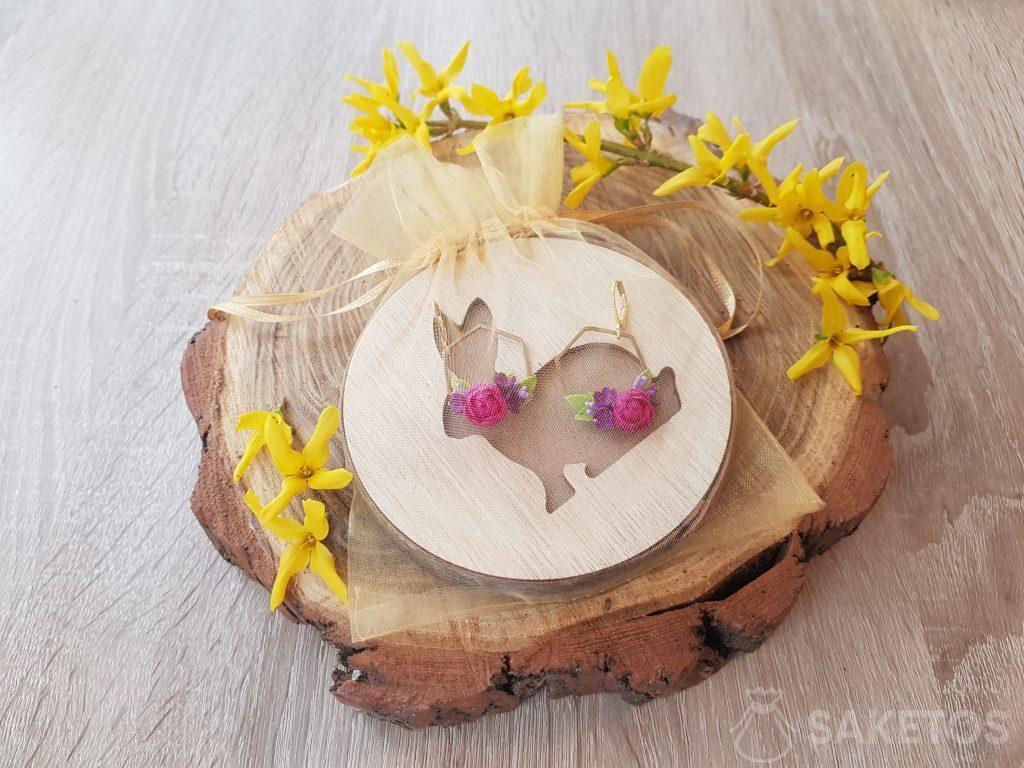 Earrings packed in a golden organza pouch