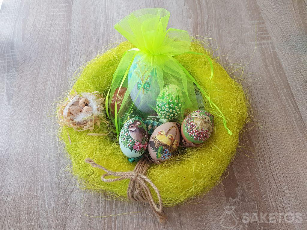 Hand-painted Easter eggs in neon green organza pouches