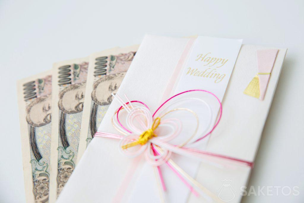 Money inserted into the wedding greeting card