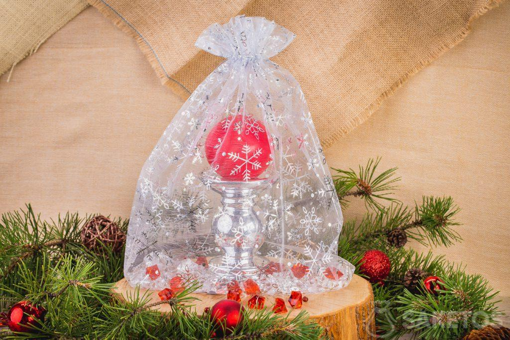 Candle in a decorative organza Christmas bag