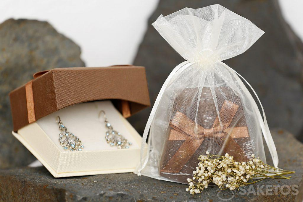 Golden satin pouch in the role of packaging for jewellery
