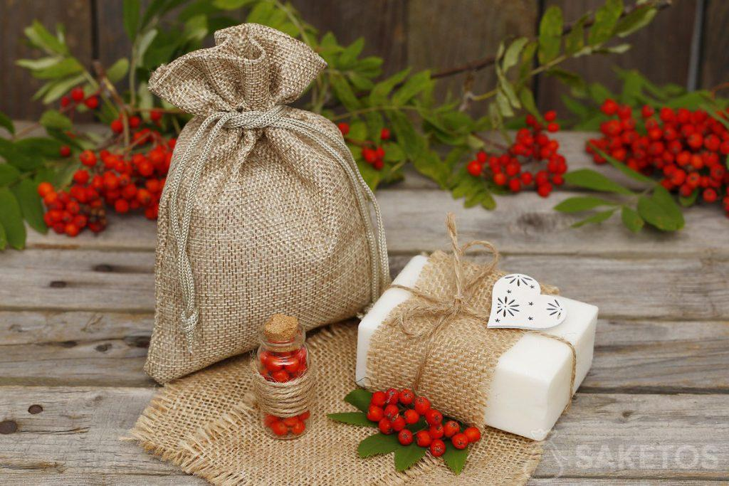 Packaging natural soaps in jute bags.