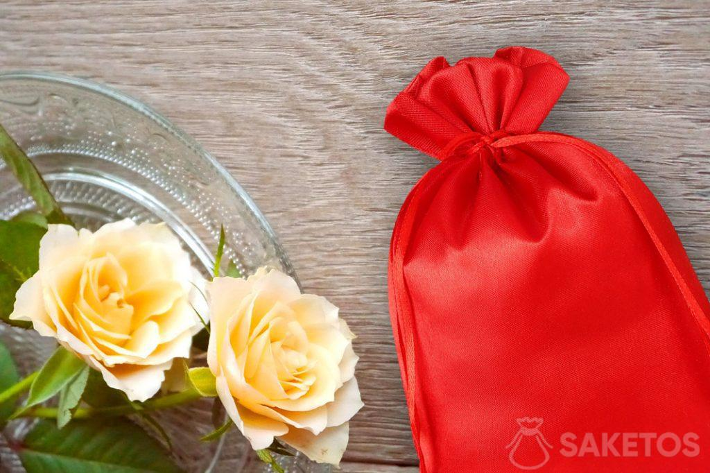 Red satin pouch and roses