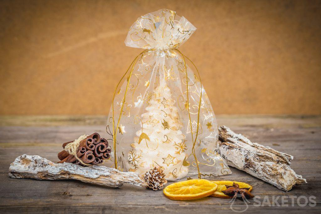 Christmas organza bags used as packaging for a candle