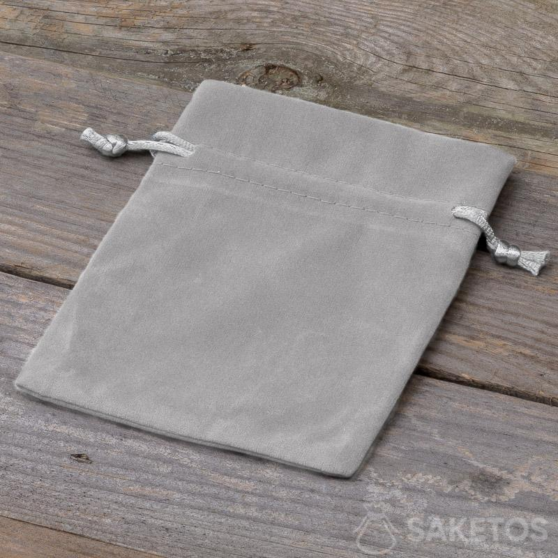 A decorative bag made of grey velour