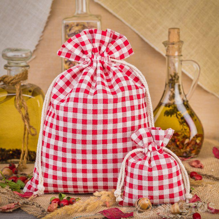 Fashionable red checkered linen bags are a great decoration for a kitchen counter or shelf