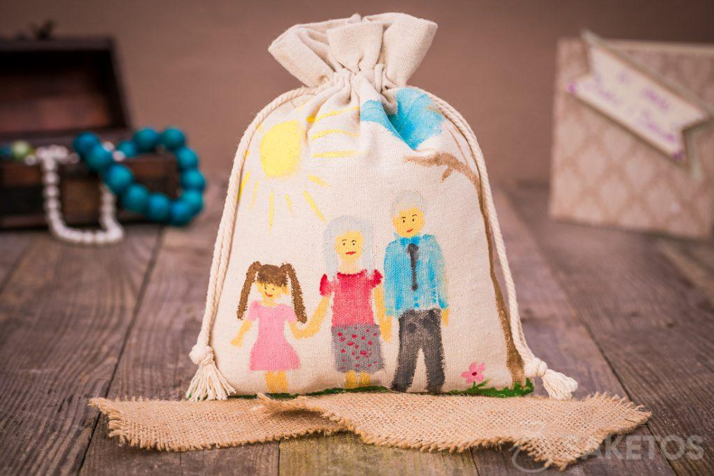 Linen gift bag for loved ones with designs painting on using acrylic paints