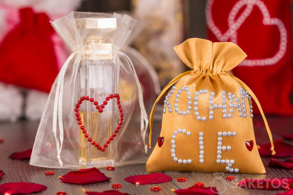 Material bags can be hand decorated with pearls and jets