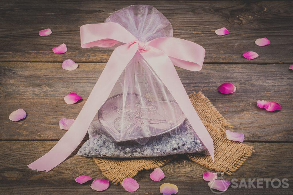 A decorative ribbon bow attached to an organza bag