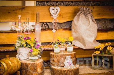 Decorative linen and jute bags in a rustic style for the wedding table