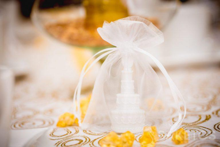 Decorative table elements packaged in organza bags
