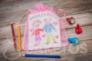 Gift - a greeting card for grandparents packed in an organza bag
