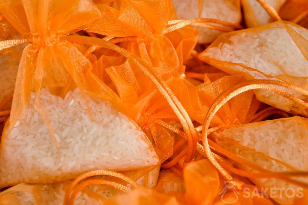 Orange organza bags with rice