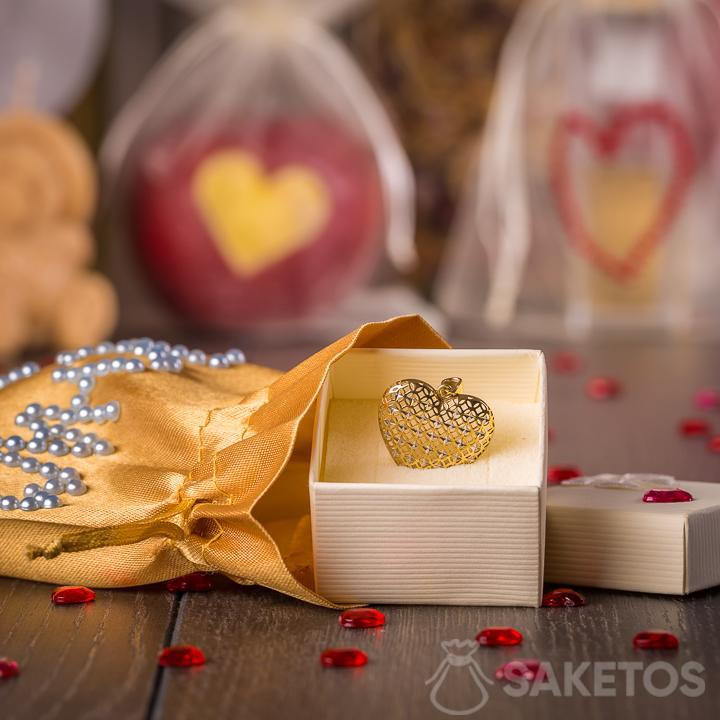 Jewellery presented as a gift in a gold satin bag