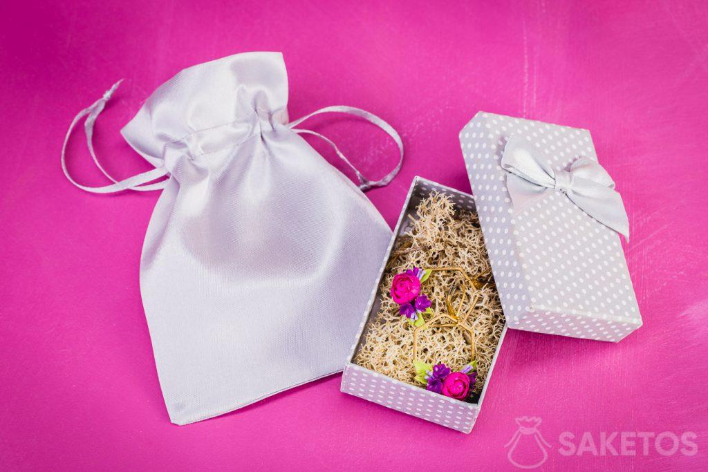Earrings presented as a gift in a jewellery box and satin pouch