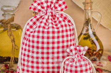 Fashionable red checkered linen bags make a great decoration for a kitchen counter or shelf