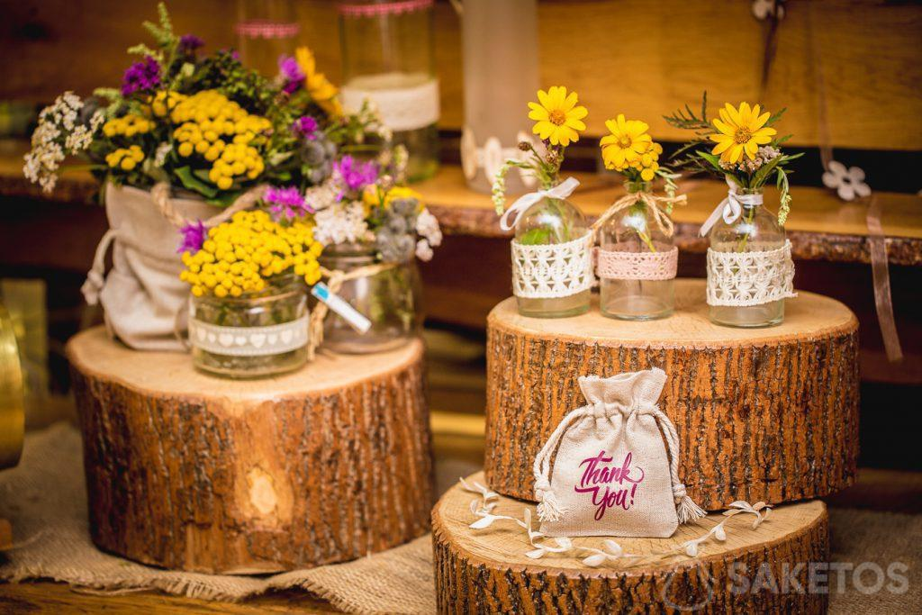 Linen bags as a decoration for flower pots and packaging for gifts for wedding guests