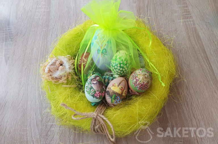 Hand-painted Easter eggs in neon green organza pouches.