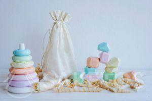 Montessori-style aids in a small linen eco-bag