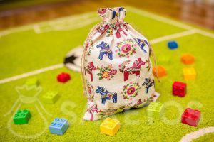 A decorative bag for the children's room to store Lego Duplo blocks