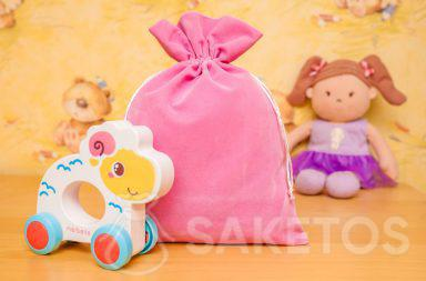 9. Velour fabric bags are ideal as a decorative toy storage solution